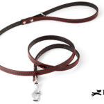 collare in pelle nera con cucitura rossa